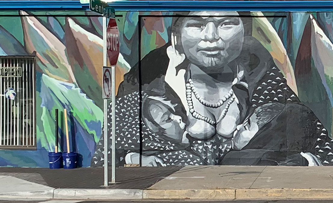 black and white mural of woman breastfeeding