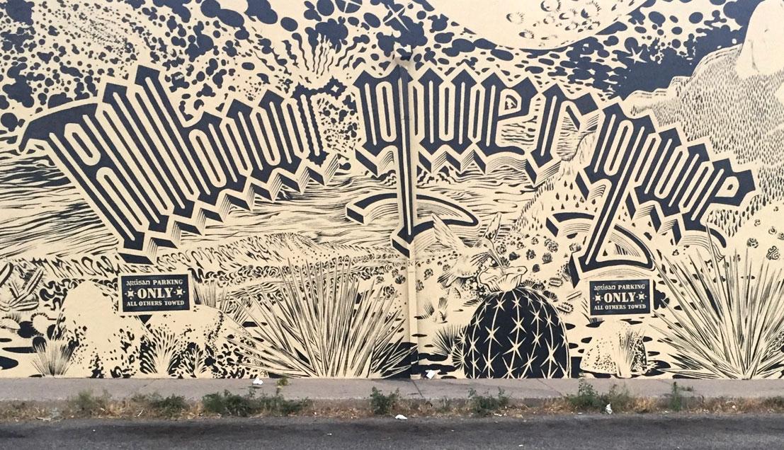 black and white line mural desert basin and lettering
