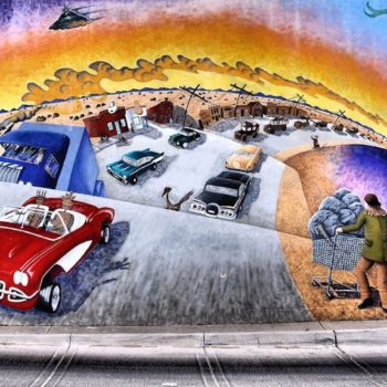 painting of cars on highway in desert