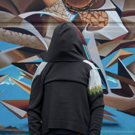 hooded figure from behind