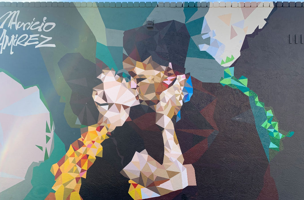 mural of two pixelated figureskissing
