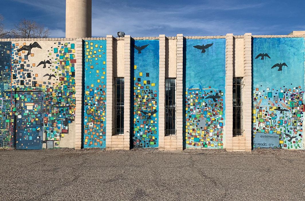 mural of flying bird pixels