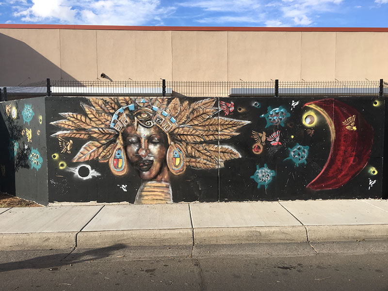 mural of indian woman closing eyes