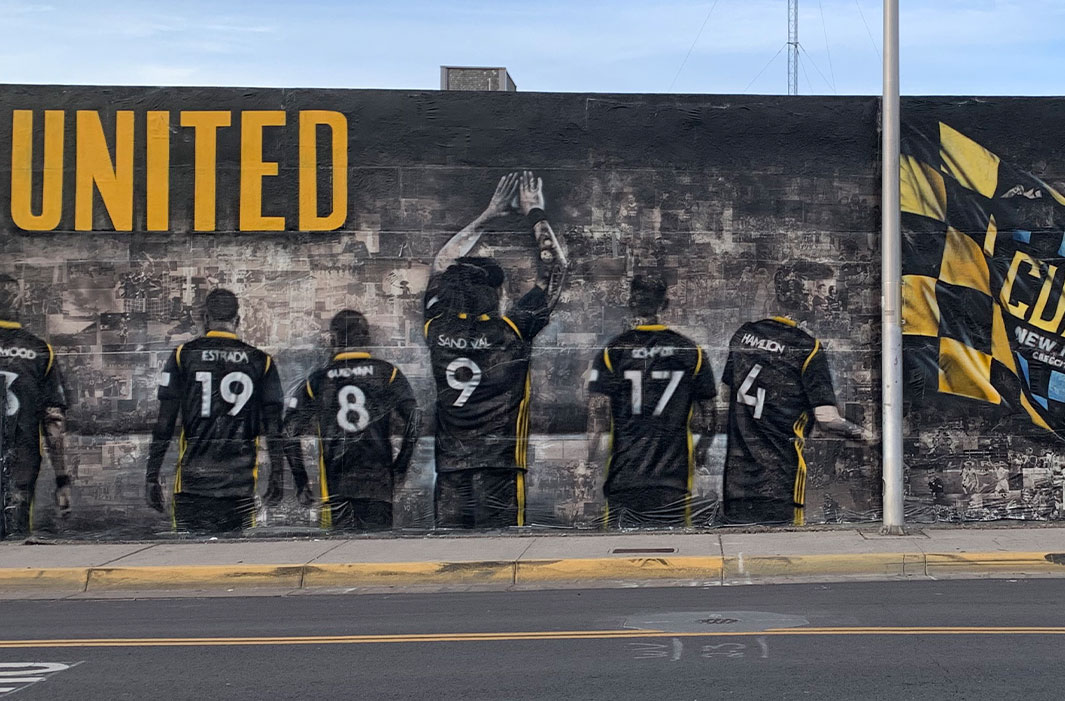 mural of players in jerseys