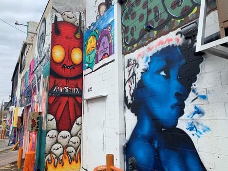 Various murals in alley